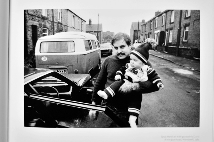 Spud Marshall with grandchild Carla, Rimington Road, Wombwell, 1985