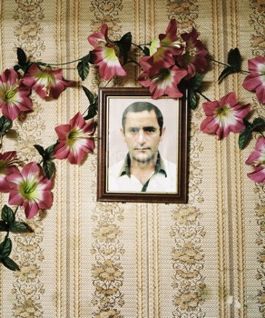 Photo of a deceased husband in a refugee centre on Shamgona island. Many Georgian women who were forced to flee Abkhazia lost their husbands.